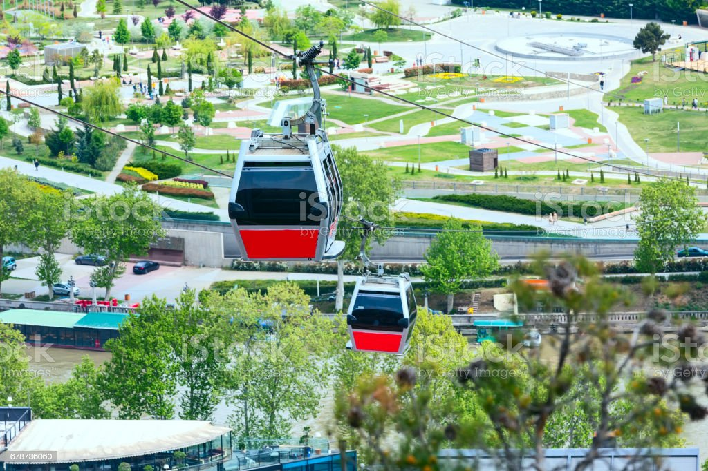 Tbilisi, Georgia cable car cabins and aerial city skyline royalty-free stock photo