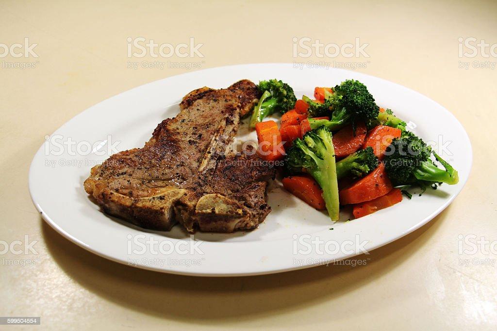 T-bone steak again stock photo