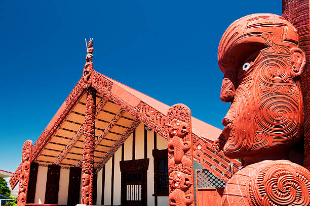 Te Papaiouru Marae, Rotorua, New Zealand - November 11 Rotorua, New Zealand - November 11, 2013: Maori wood carving outside of Te Papaiouru Marae, a Maori meeting house in the tourist town of Rotorua, New Zealand rotorua stock pictures, royalty-free photos & images