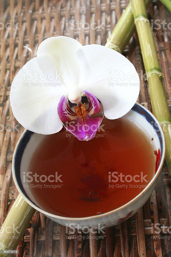 Tea and Orchid royalty-free stock photo