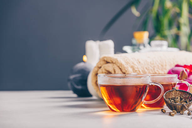 Tea and SPA composition Tea set and spa settings on concrete background. Natural spa treatment and relaxation concept spa belgium stock pictures, royalty-free photos & images