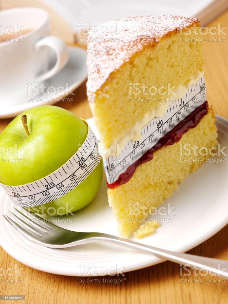 Tea and Tape Measure with a Sponge Cake & Apple stock photo