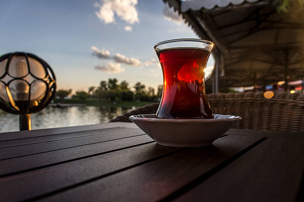 Tea and tranquility Peace, Relaxation, Unique, Landscapes, chairs, loneliness, Hot Drink, No People, Outdoors, Sailing Ship , Turkish Tea , Food And Drink, City Of Sunrise,  Sunlight, Heat, Color Image, Teaspoon, Drinks , cups of tea , tea, cups, bowls, beverages, soft drinks, pain, urgent, bitter, tables, caffeine , liquid, coffee, brown, browning, breakfast, steal, stealing, aromatic, morning, lust , love, flavor, turkish culture, glass, light grafiker stock pictures, royalty-free photos & images