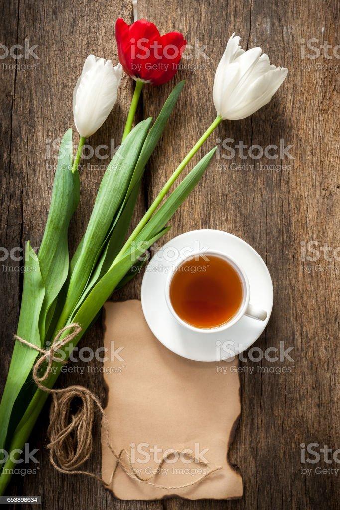 Tea and tulips stock photo