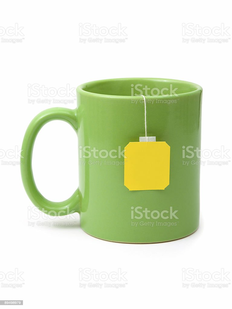 Tea bag in cup royaltyfri bildbanksbilder