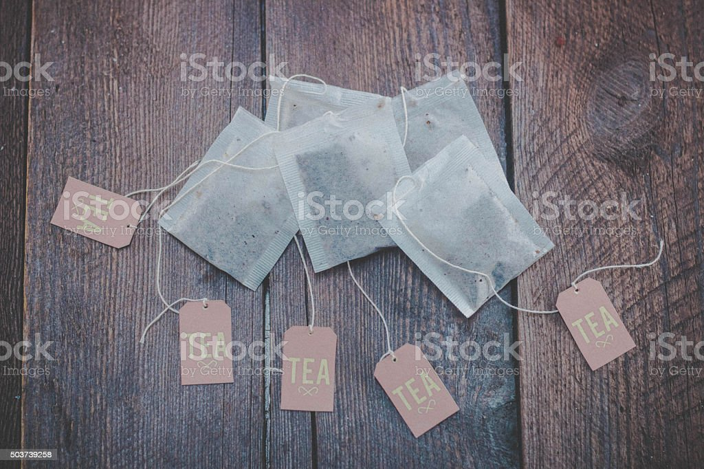 Tea bags on wooden background stock photo