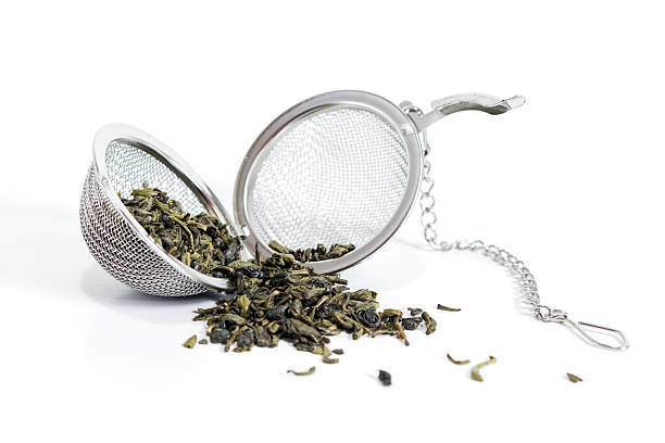 tea ball - tea leaf stock photos and pictures