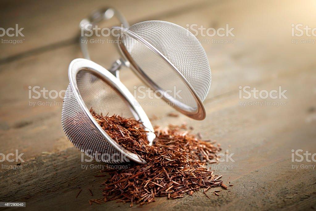 tea ball with rooibos tea stock photo