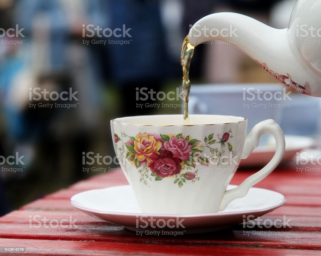 tea being poured stock photo