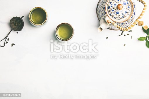 Tea composition, green tea on grey concrete background, flat lay