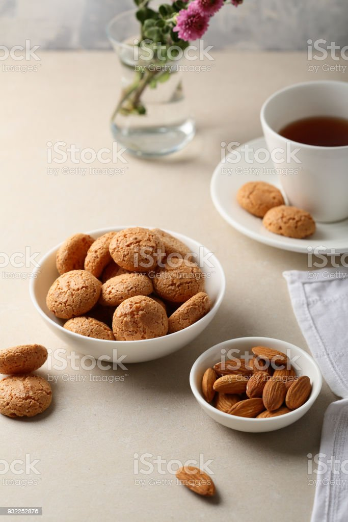 Tea, cookies and nuts on table, food closeup stock photo