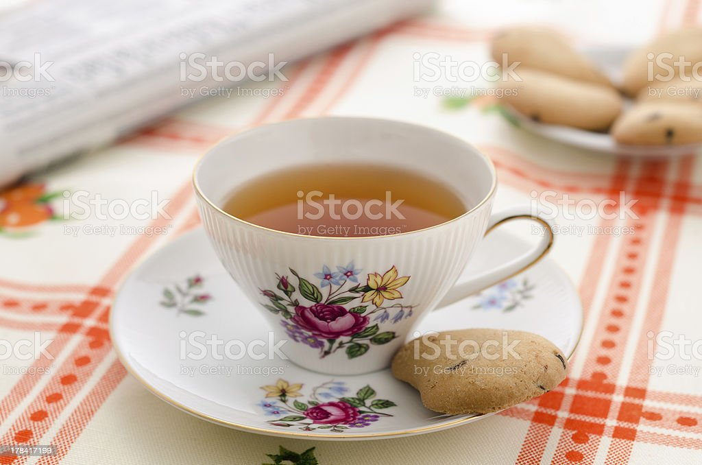 Tea, cookies and the newspaper royalty-free stock photo