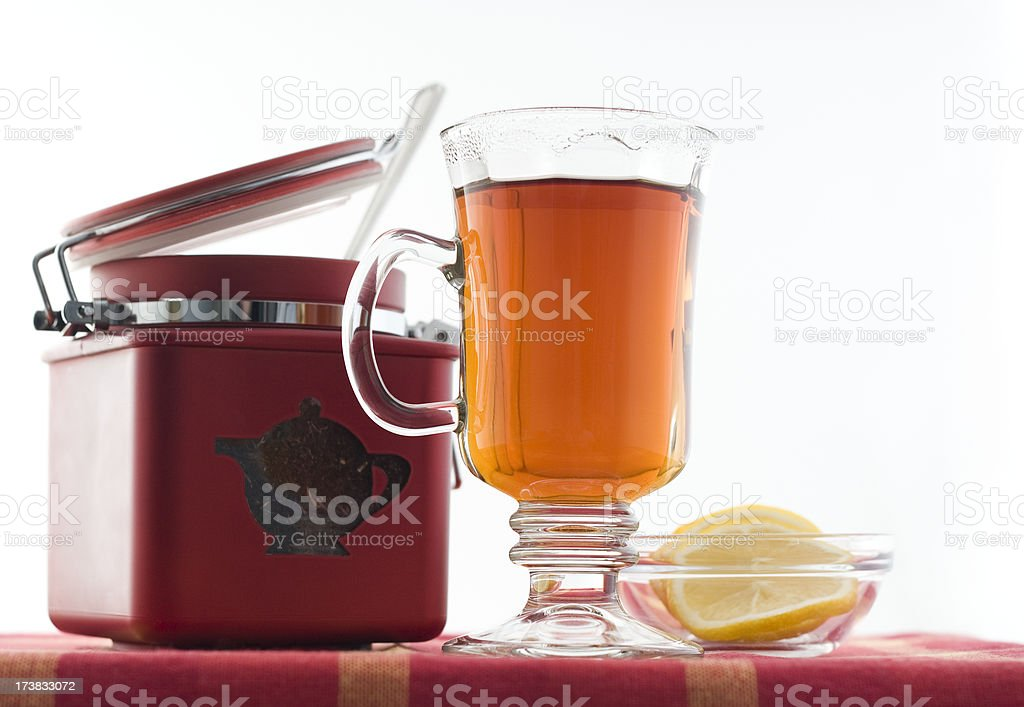 Tea cup and red caddy. stock photo