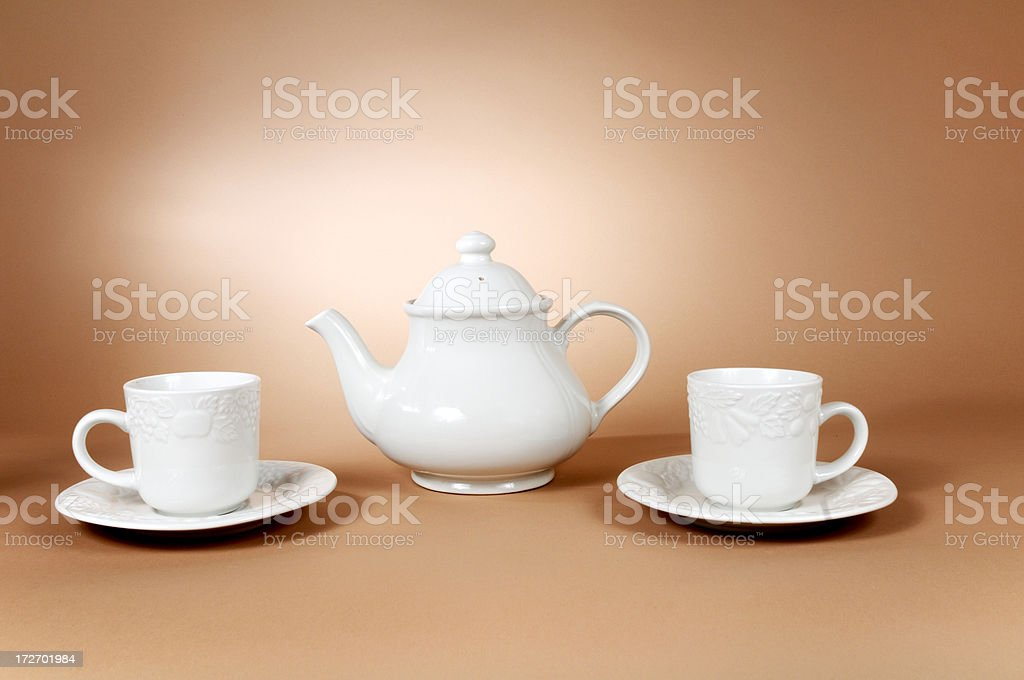 tea cup and teapot on brown background royalty-free stock photo