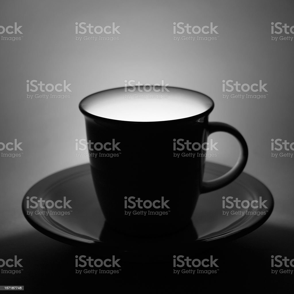 Tea Cup filled with light stock photo