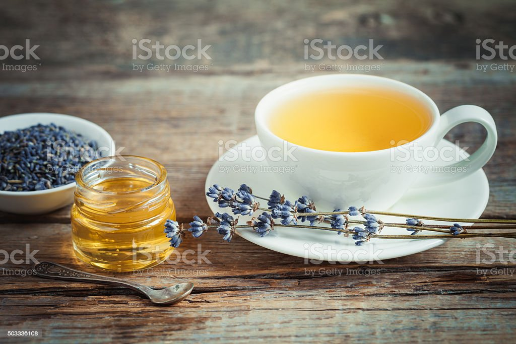 Tea cup, honey and dry lavender flowers stock photo