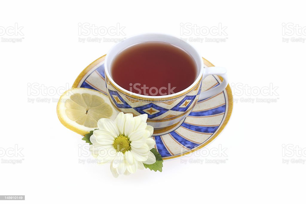 Tea cup, lemon and flower royalty-free stock photo