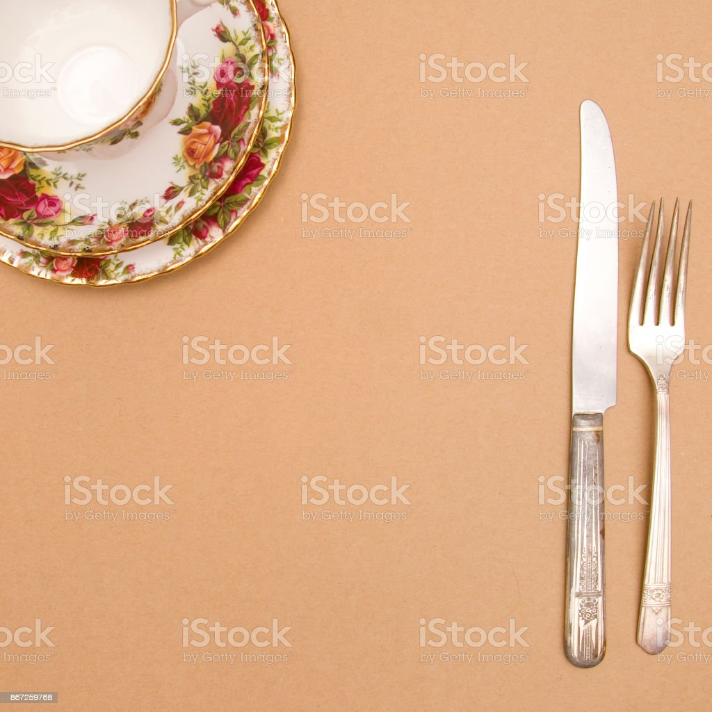 Tea Cup on a Brown Background - Add your dinner invitation stock photo