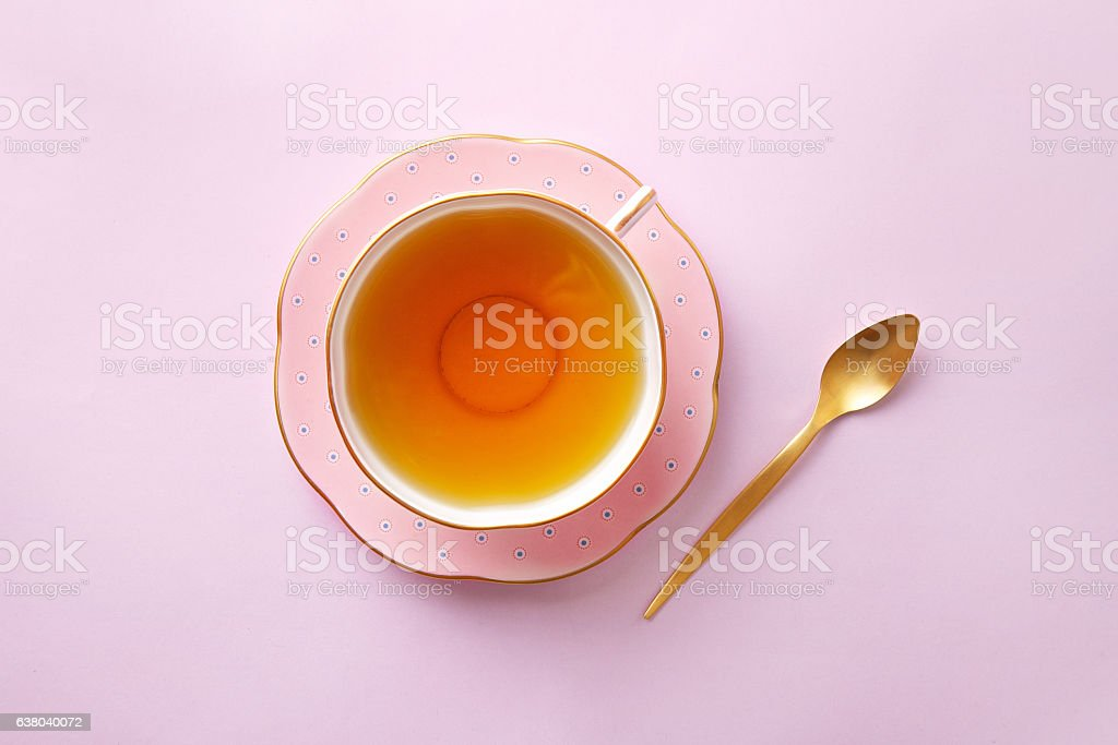 Tea cup on pastel pink background. Top view stock photo