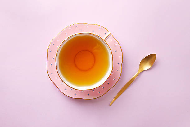 Tea cup on pastel pink background. Top view - Photo