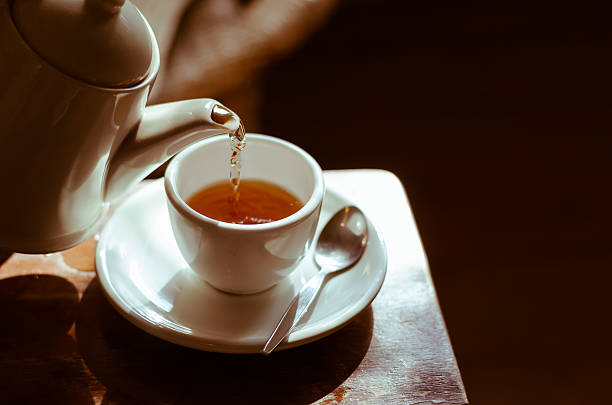 o horário do chá. - chá bebida quente - fotografias e filmes do acervo