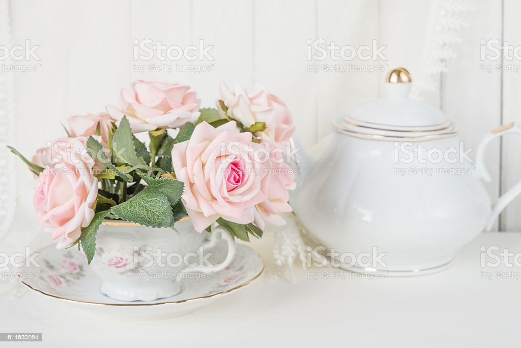 Tea cup, teapot and roses stock photo