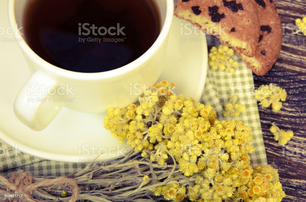 tea cup with dry flowers stock photo