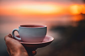 Tea cup with sunrise background