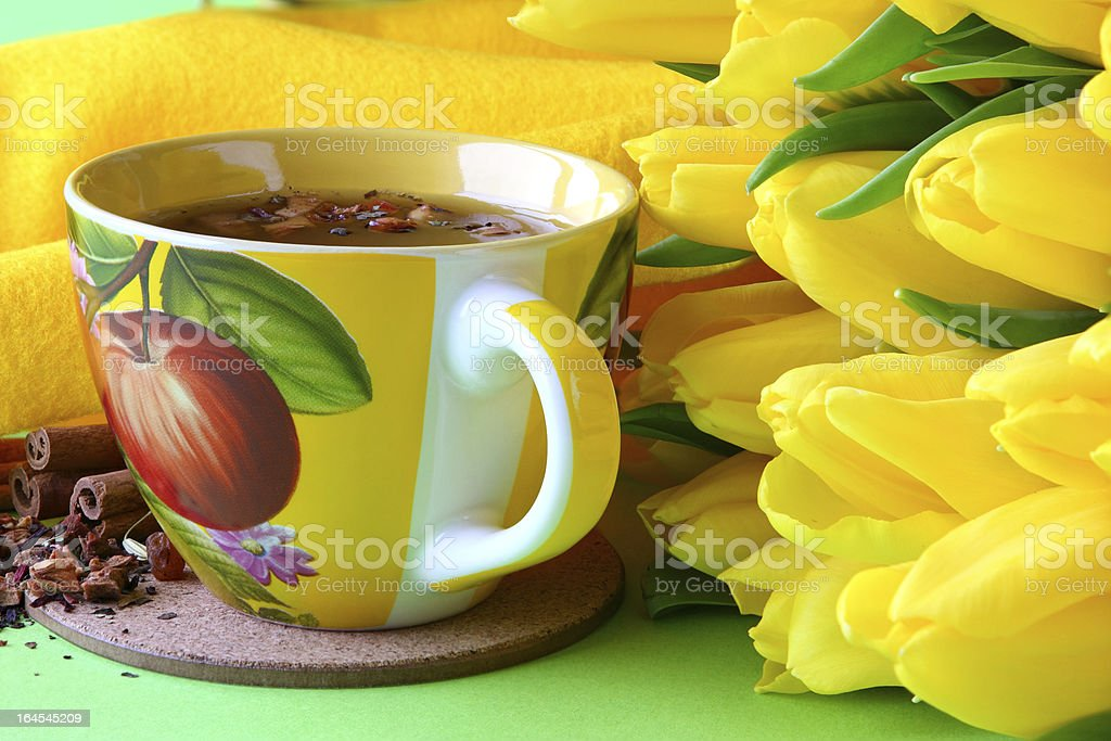 Tea cups and yellow tulips royalty-free stock photo