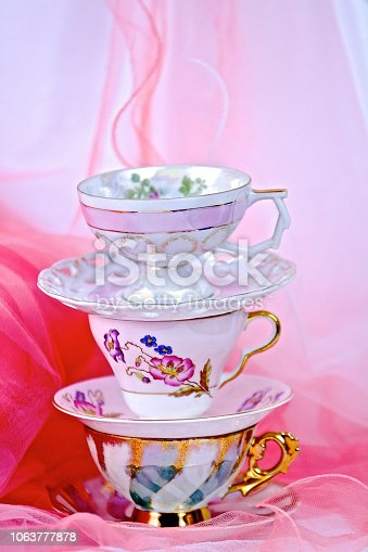 Vibrant pink background with tea cups