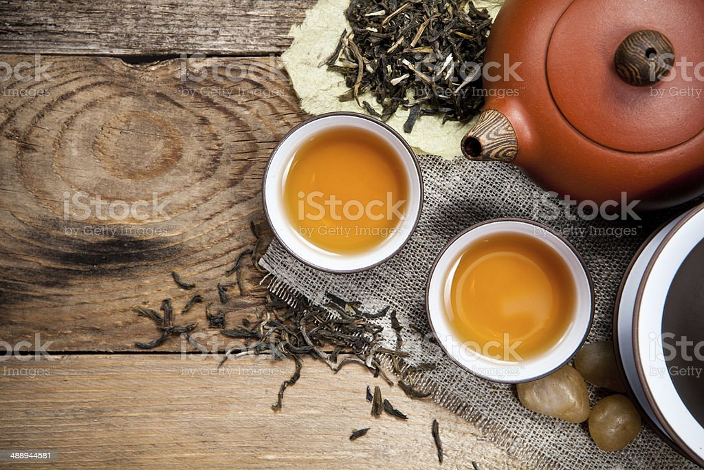 Tea cups with teapot on table - Royalty-free Breakfast Stock Photo