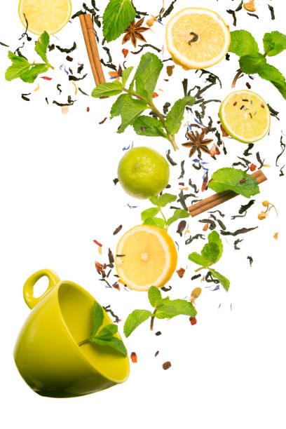 tea falling down to the cup. levitating tea. concept of tea - liść mięty przyprawa zdjęcia i obrazy z banku zdjęć