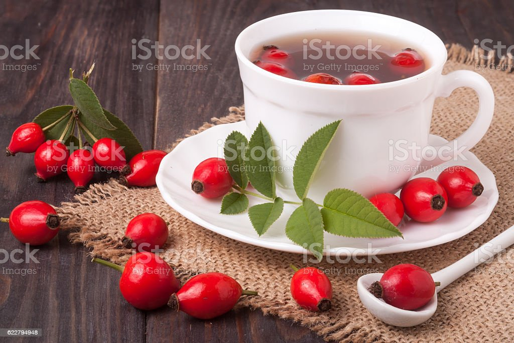 Tea from the hips on the wooden background stock photo