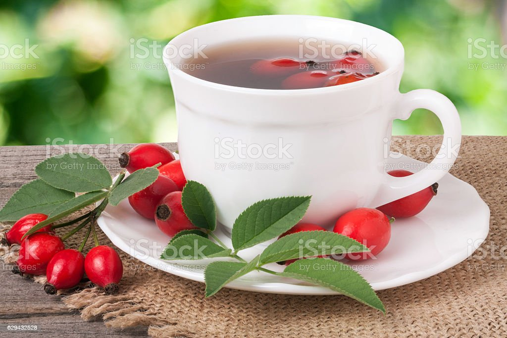 Tea from the hips on the wooden table with a stock photo