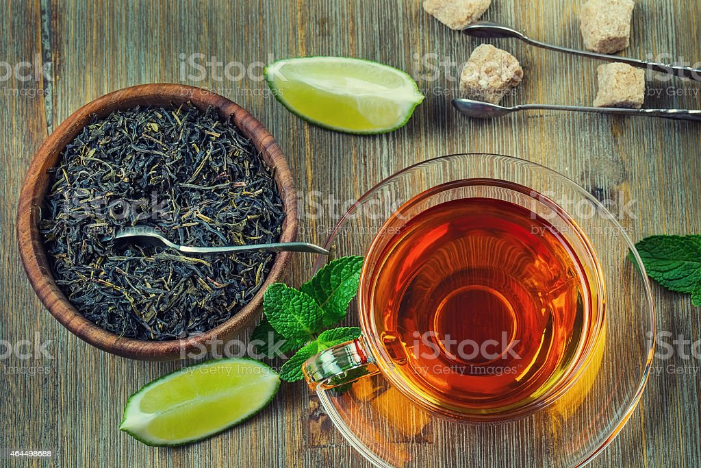 Tea in a glass cup, mint leaves stock photo