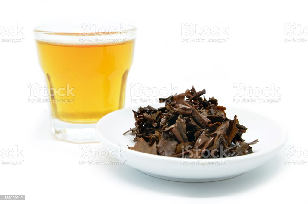 Tea in a glass cup with used tea leave. stock photo