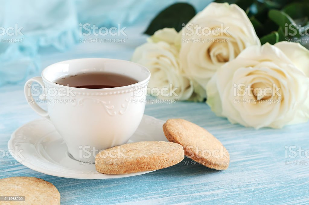 Tea in elegant porcelain cup and shortbread stock photo