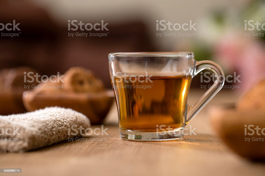Tea in glass cup with cookies stock photo