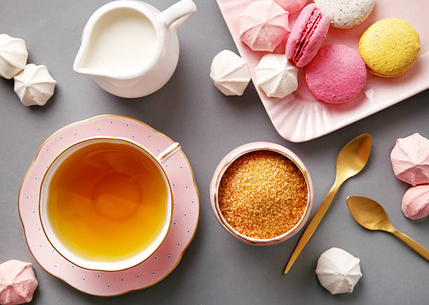 Tea in pink cup flat lay on gray background stock photo