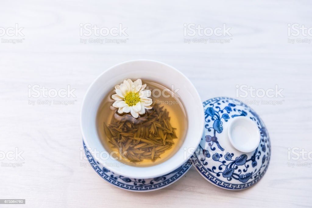 Tea in tea cup on table stock photo