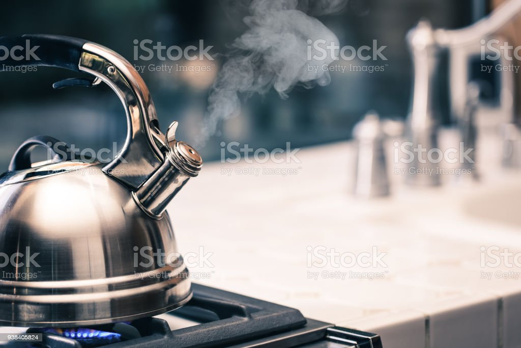 Tea kettle with steam stock photo