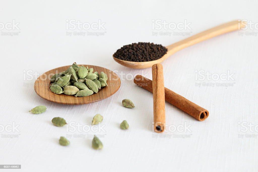 Tea leaf & Spices (cardamom, cinnamon) for Indian Sweet Chai stock photo