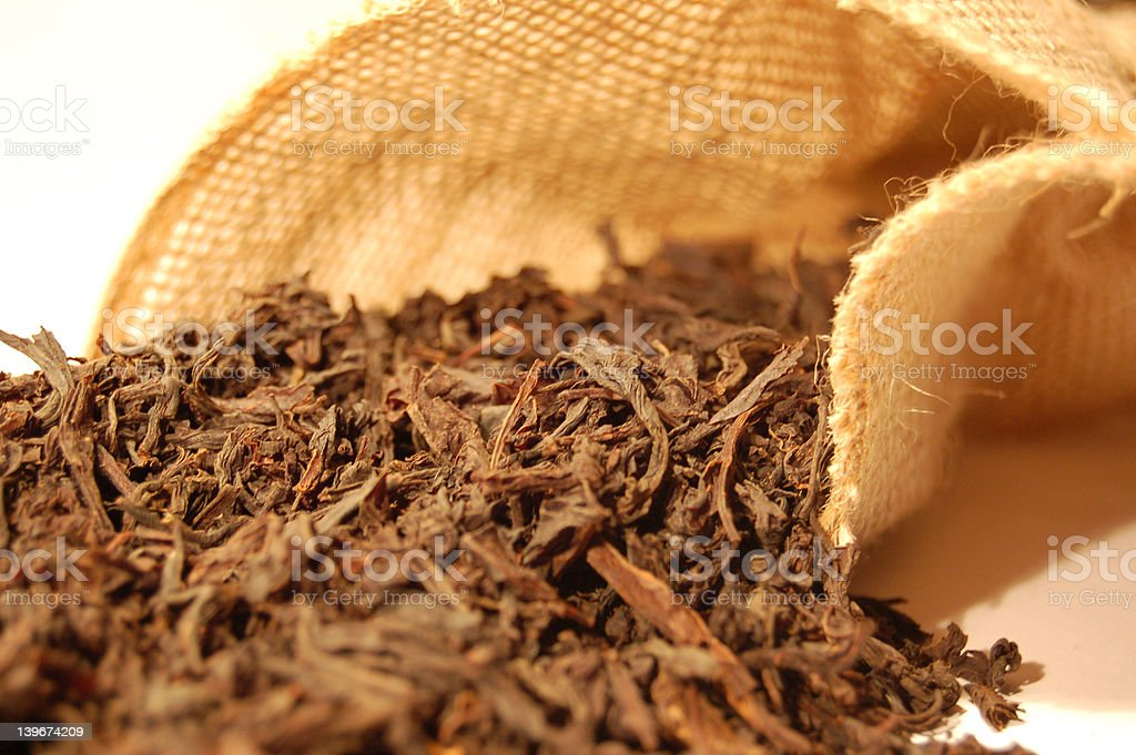 Tea leaves and canvas sack 1 royalty-free stock photo