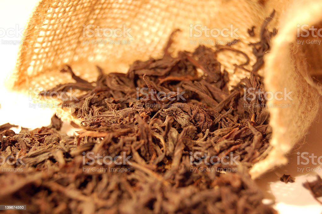 Tea leaves and canvas sack 2 royalty-free stock photo