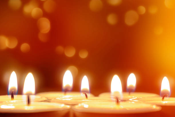 tea lights in front of a festive background stock photo