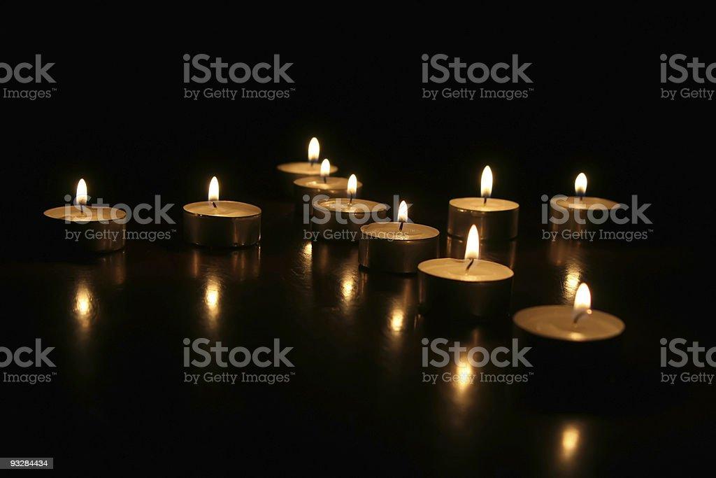 Tea lights on the table stock photo