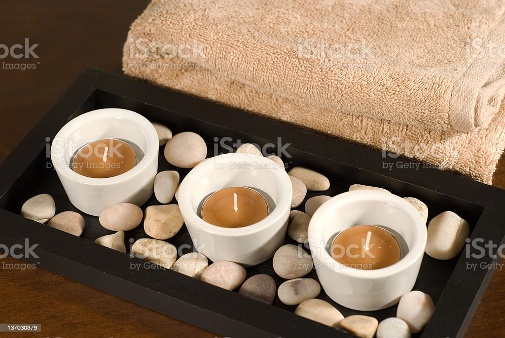 Tea lights with towel royalty-free stock photo
