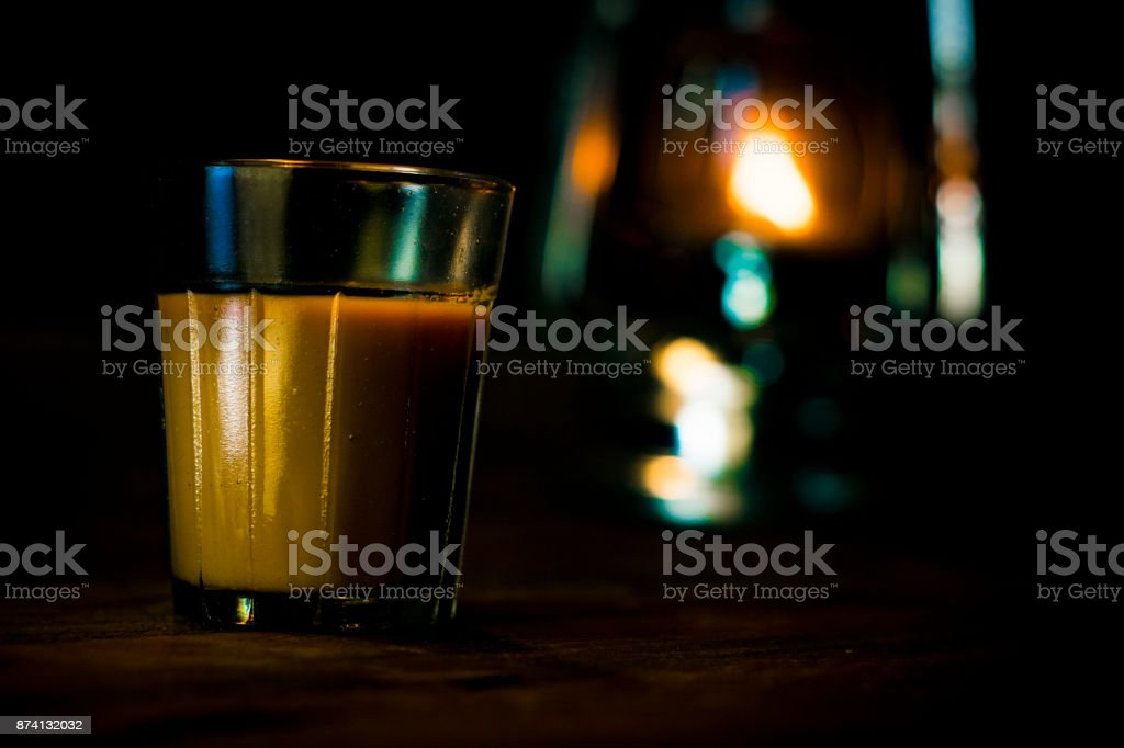 Tea on Wooden Table with Beautiful Glowing Environment stock photo