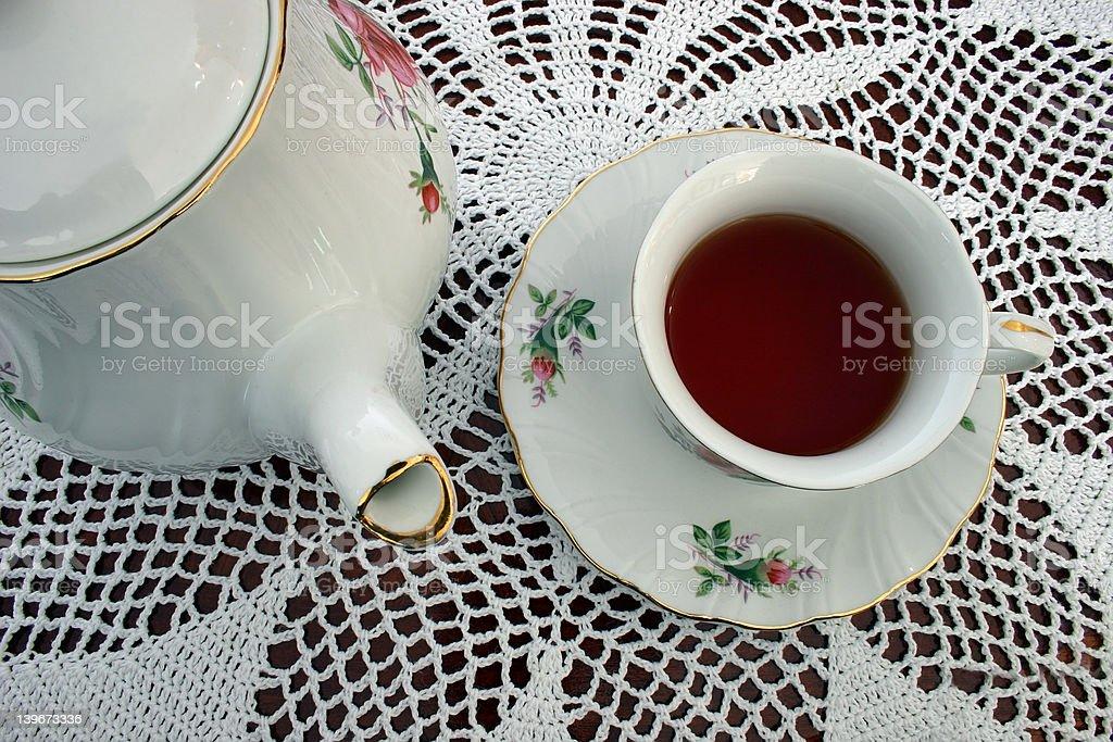 Tea Pot and a Cup of Tea royalty-free stock photo