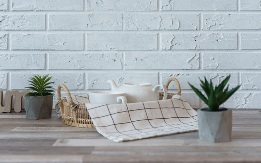 Tea pot and ceramic cups on Kitchen counter